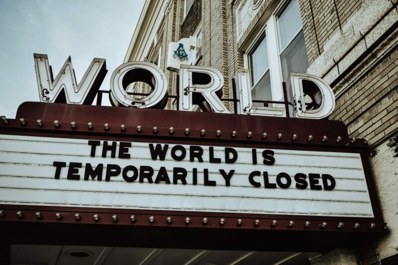 The World is Temporarily Closed letters in Brown colour